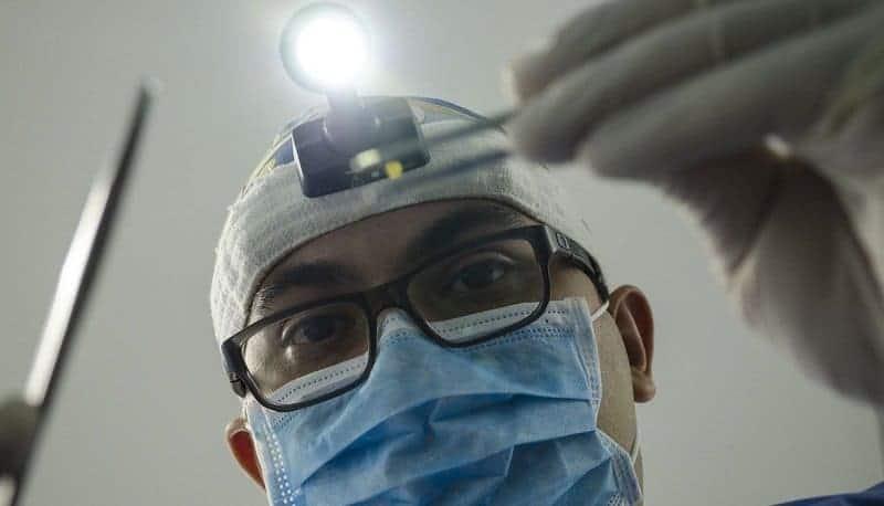 Чёрные точки на зубе: причины появления и методы лечения